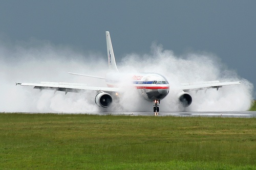 American Airlines Airbus A300-605R with massive spray on landing rollout