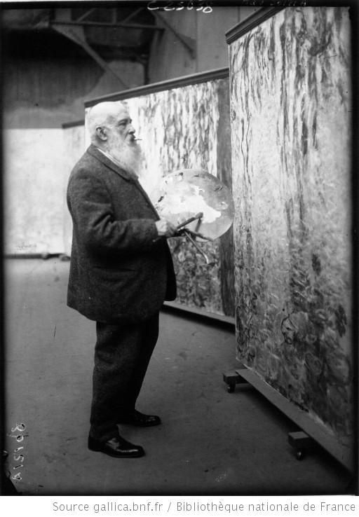 Claude Monet in front of his paintings 'The Waterlilies' in his studio at Giverny 1920