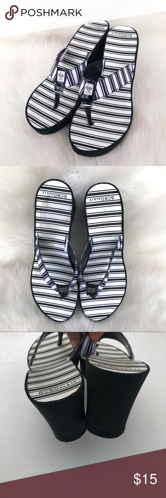 """BCBGeneration platform flip flops Super cute wedges/platforms from BCBGENERATION. Black and white with silver logo Heel is 3.25"""" high Great used condition with slight signs of wear. Mostly on the sole. Size 9, definitely fits more like an eight. BCBGeneration Shoes Sandals"""