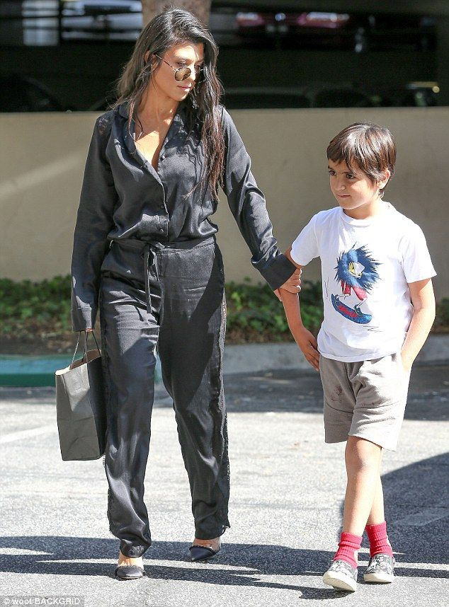 Her little man: Kourtney Kardashian, 38, bonded with son Mason Disick, seven, on Tuesday in between filming scenes for reality show Keeping Up With The Kardashians