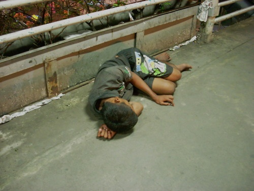 """""""A boy sleep over the bridge"""" Jakarta's streets have become places where children spend their days sleeping and begging or working in dangerous conditions"""