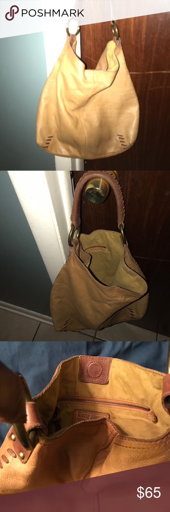 Authentic Vintage Inspired Lucky brand Bag. Authentic Lucky Brand Purse with brown stitching.  Like. New condition.  One zipper pocket inside with top magnet clip closure.  Slouchy comfy hobo styled lucky brand bag that can be worn I shoulder or as hand bag.  I always wear on shoulder. Lucky Brand Bags Hobos