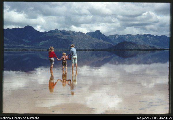 The three Truchanas children hold hands in the serene Lake Pedder shallows, Tasmania, 1971