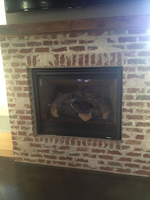 Smeared mortar brick fireplace