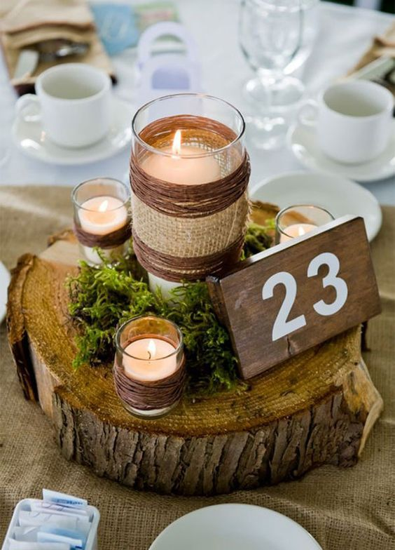 Rustic wood wedding reception centerpiece
