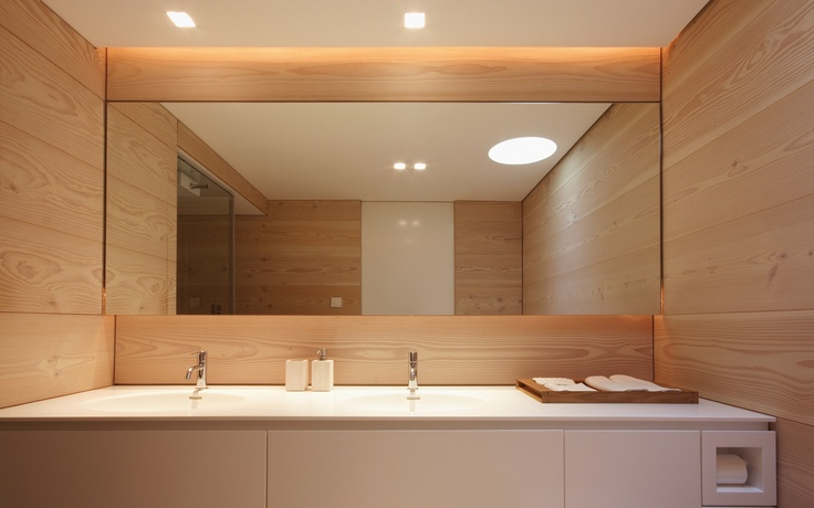 :: BATHROOMS :: Lake Lugano House, Scheis. Photo Credit: JM Architecture featured on Dinesen.  The use of mirror flush detailing and the warmth of wood ... The next time someone tells me I can't use wood for walls in a bathroom, I will show them this perfect example of using a simple colour palette makes for a timeless interior.  Do you see that full height door detail to ceiling - covet this simple box interior. #bathrooms