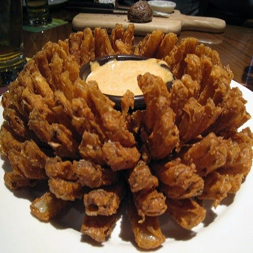 Make Outback Steakhouse's Blooming Onion at home tonight for your family with our secret restaurant recipe.