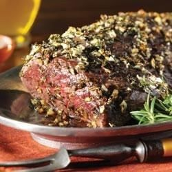 Beef tenderloin is roasted with fresh thyme and rosemary and served with a zesty horseradish sauce.