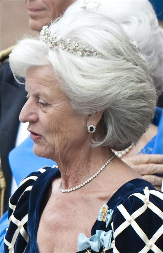 Another of Queen Silvia's Ladies-in-Waiting, wearing a diamond tiara and the formal dress that goes with her position.