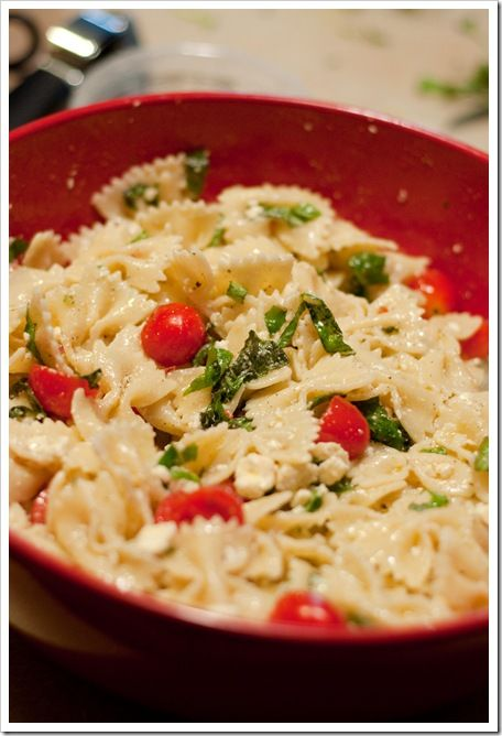 JILL'S TOMATO BASIL PASTA SALAD    1 box bowtie/farfalle pasta    3/4 cup extra virgin olive oil {I used  Bertolli}    Fresh basil, sliced into small strips    Fresh garlic to taste, pressed/crushed {I used 5 cloves…use as much/little as you prefer}    Grape tomatoes    Feta Cheese {I used Tomato & Basil} OR Fresh Mozzarella, cut into bite sized chunks    Sea salt, to taste    Pepper, to taste    Toasted almonds {optional}