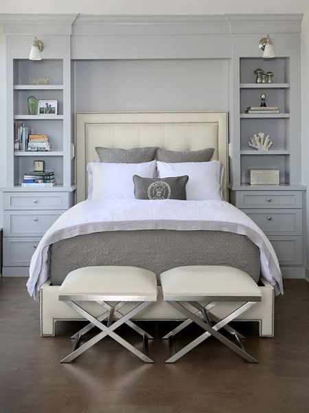 Beautiful light grey storage cabinets and shelves around head of bed