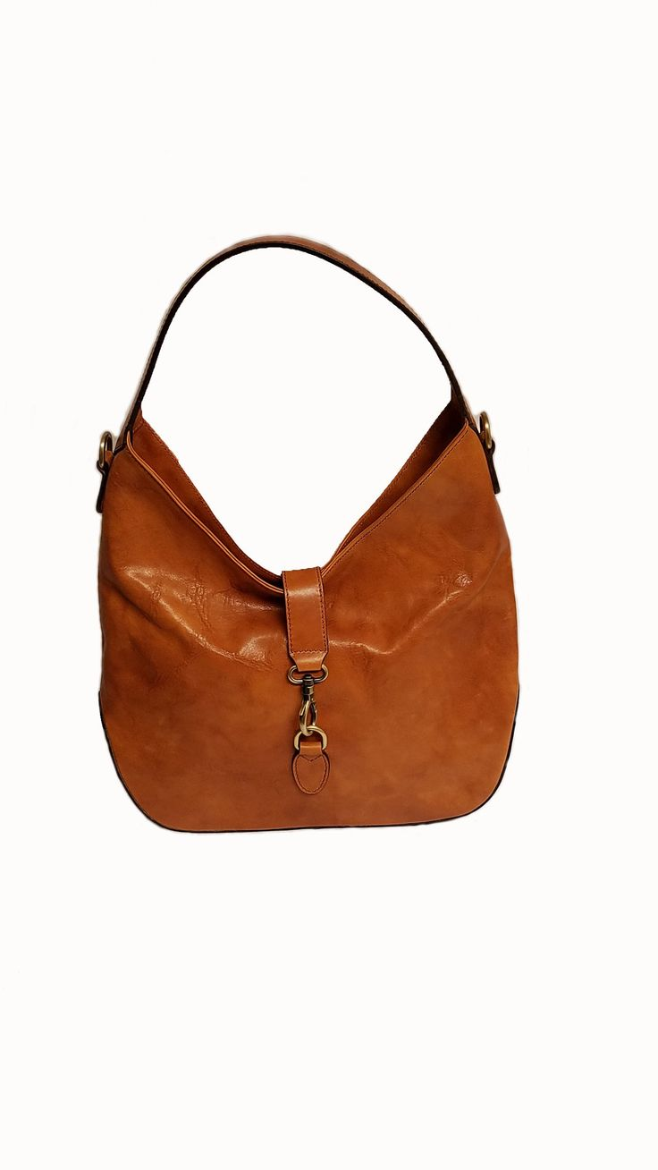 Shoulder bag Detachable leather adjustable shoulder strap Size (inches) : 14.37 x 11.02 x 2.56 Weight (Kg) : 1 Made of : Leather