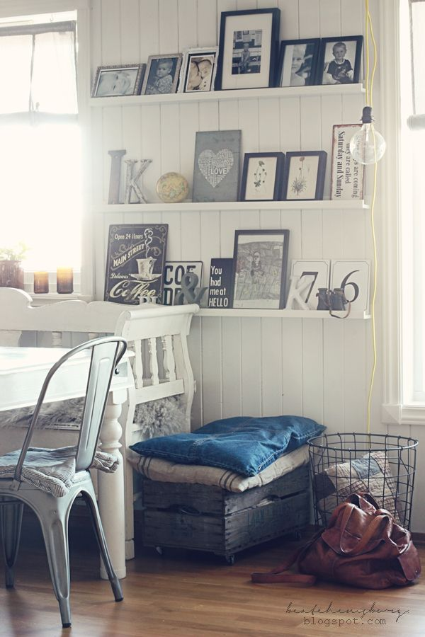 Low profile picture frame wall. Love the shelves so you don't have to hang all the pictures!