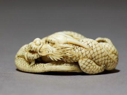 Netsuke in the form of a dragon coiled around a bowl.  Ashmolean Museum.