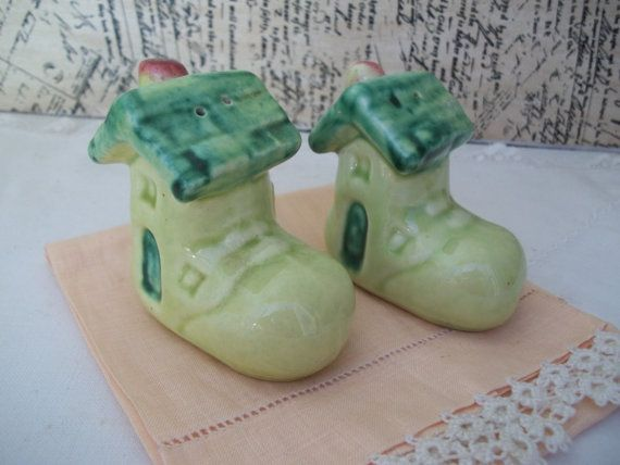 Such a sweet vintage figurine set of salt and pepper shakers shaped like Mother Gooses old ladys shoe house! Excellent shape ~ free of chips, cracks and repairs, unfortunately both stoppers are missing, but that doesnt keep them from displaying well! Measure approx. 2 3/4 tall and 2 3/4 wide at widest point.  Too cute!! ~~~~~~~~~~~~~~~~~~~~~~~~~~ Props not included. All photos are our own stock and are not to be used or copied without permission. ~~~~~~~~~~~~~~~~~~~~~~~~~~~~~~~~~~ Shipping…