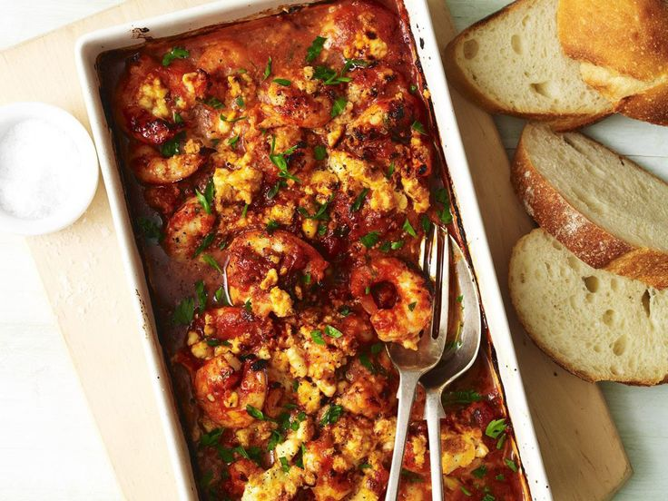 This is a real crowd-pleaser of a dish, hot, garlicky prawns with fetta in a rich tomato sauce. Serve with a crisp green salad on the side, and lots of crusty bread for mopping up the sauce.