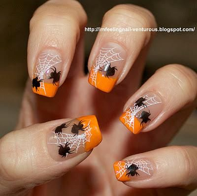 I like the orange tips but not so much the design. Halloween nails!