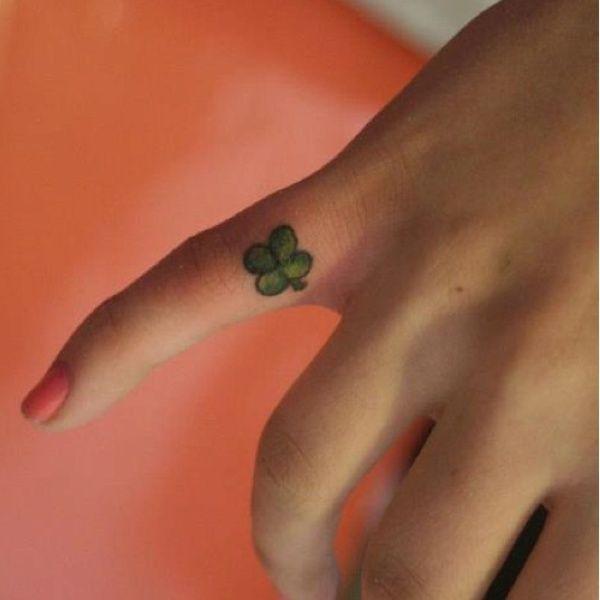 Green Shamrock Finger Tattoo - Cute Four Leaf Clover Tattoos, http://hative.com/cute-four-leaf-clover-tattoos/,