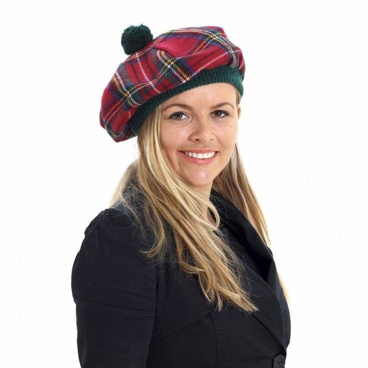 Our model wears our Brushed Wool Tartan Tam in the Stewart Royal Tartan