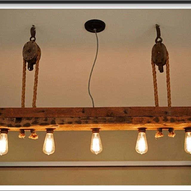 reclaimed wood light fixture above pool table