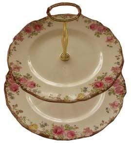 Round, double tiered handled cake platter. Non-original item.