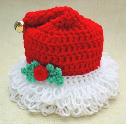Santa's Hat TP Topper Crochet PatternHave you ever thought about decorating your bathroom for the Christmas holiday season? The Santa's Hat TP Topper Crochet Pattern makes it easy to get some holiday spirit in a room that gets a lot of use each day. All you need to do is whip up one or two of these cute little Santa hats and
