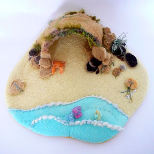 Wool felt,handstitched felt seashore  depiction showing cave,rocks,tiny fish in the sea and a small crab