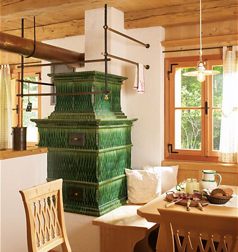 Sommerhuber tiled stove. Baroque tiles in traditional shape in variegated green