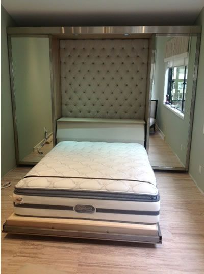 A Murphy Bed That Looks Like A Wall Of Mirrors When It S
