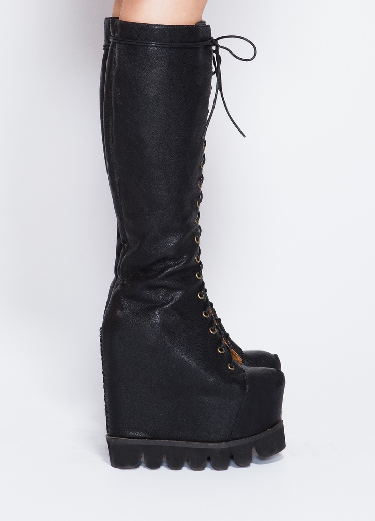 """o Jeffrey Campbell    This distressed washed leather boot features a rounded toe, adjustable lace up vamp, side partial zip closure with leather covered elastic insets at opening, and brasstone studs at mid-sole. Leather linned, rubber sole.    1 3/8"""" heel"""