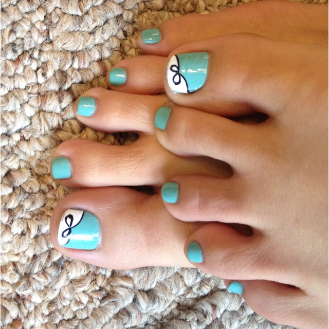 Tiffany blue painted toes with a bow