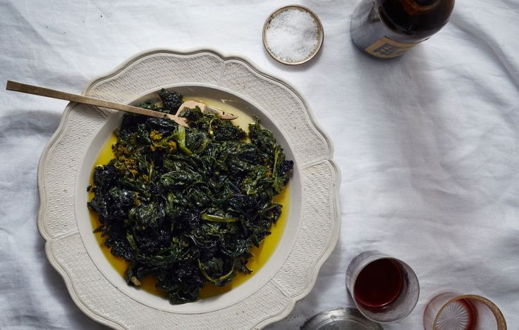 When working with a large quantity of greens, it's much easier to sauté them if they're blanched first. Their time in the olive oil is more for flavoring and reaching the ideal texture.