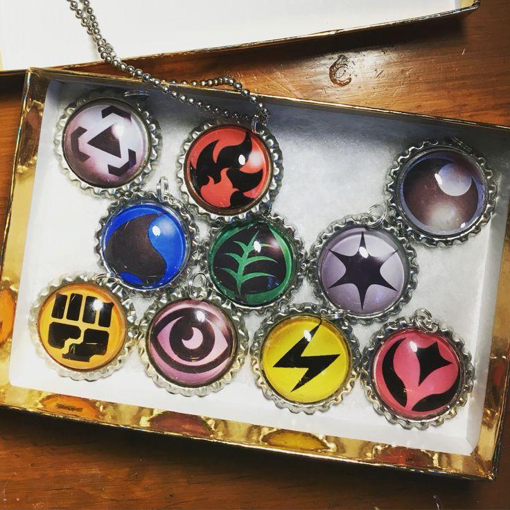 Pokemon trading card game energy pendant set for sale in my eBay store. ebay.com/usr/the_gamer_geek_boutique