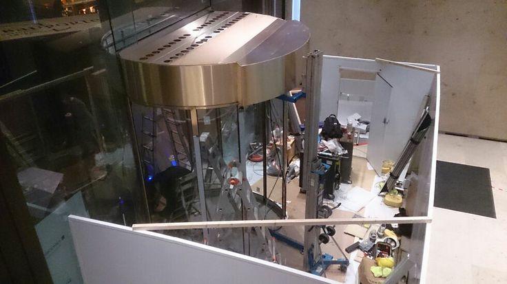 Prudential plc by M Moser Associates London. Bespoke brass sliding doors.