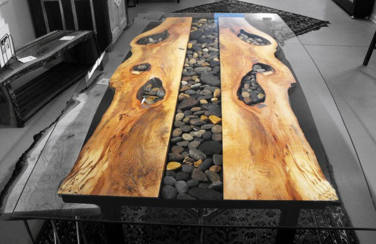 Live edge wood and pebble table, topped with glass