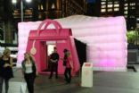 Inflatable 10m cube with pink lighting