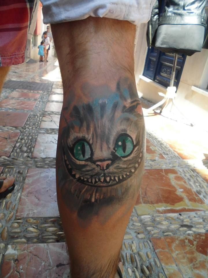 Chesire cat by Tulipan in Salvador Tattoo & Art in Marbella, Spain
