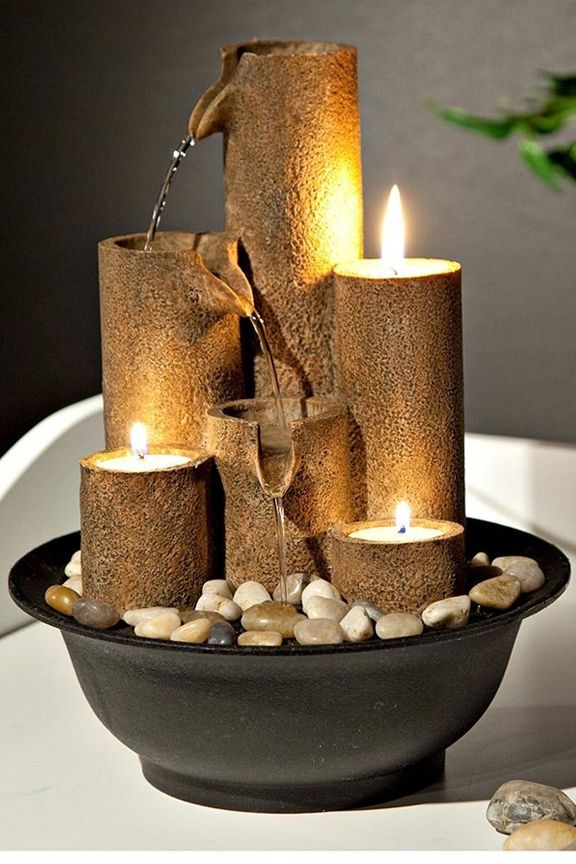 Three Candles Tabletop Fountain: Fire And Water Blend Together To Create a Captivating Scene.