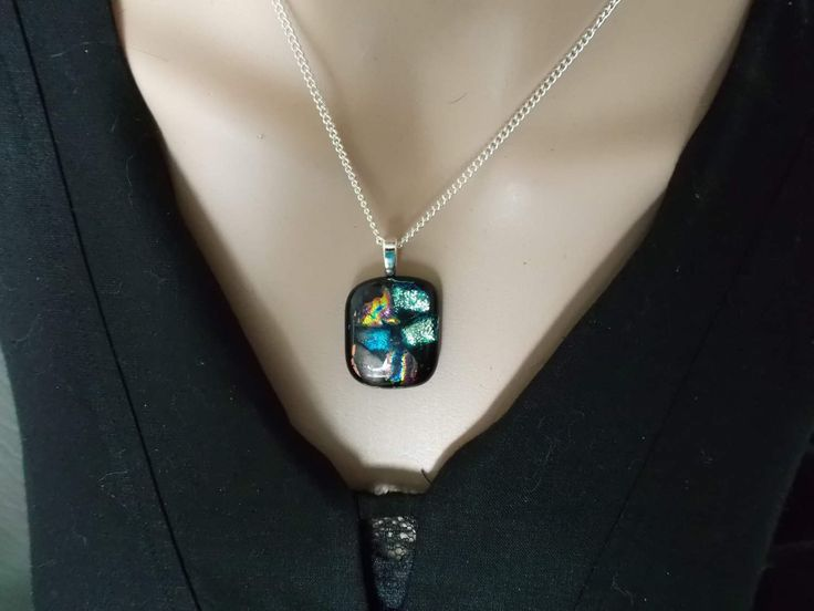 Mosaic of dichroic fused glass with black background make this striking pendant style necklace by deblizaccessories on Etsy