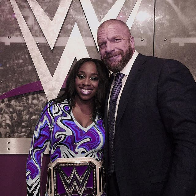Triple H congratulating the new WWE Woman's Champion Naomi at 2017 WWE Elimination Chamber #WWE