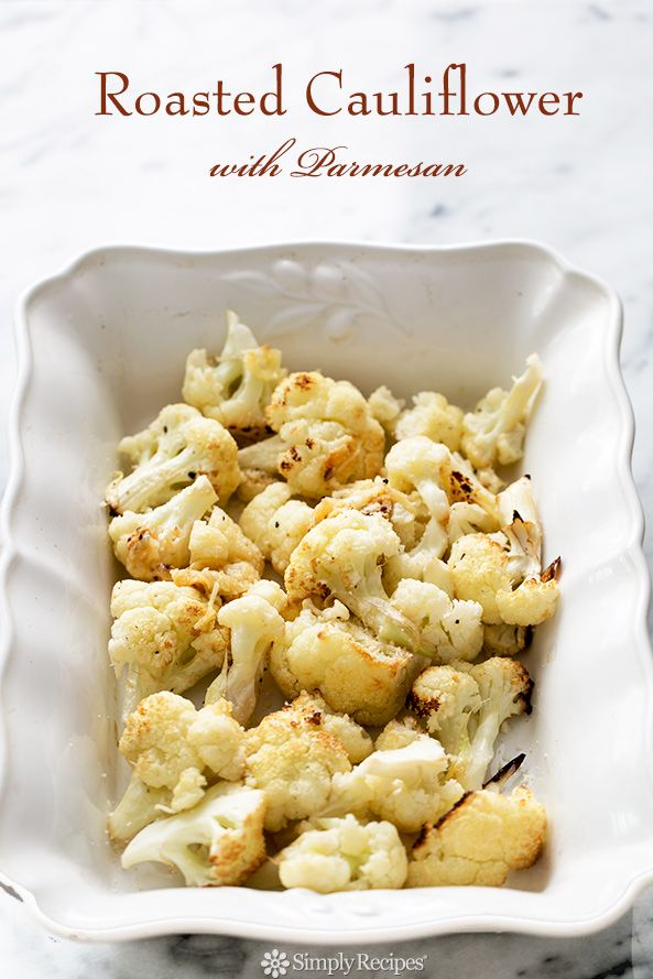 Oven-roasted cauliflower florets, with garlic, lemon, olive oil, and Parmesan cheese. The BEST way to cook cauliflower. On SimplyRecipes.com