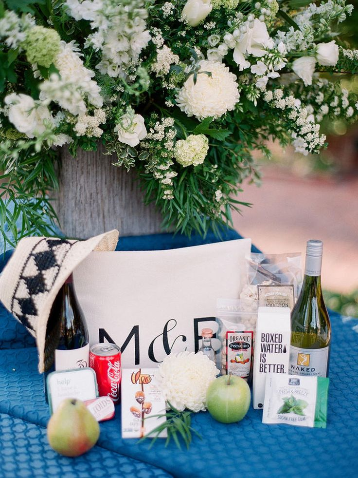 Don't want to deal with the hassle of mailing gift bags? Try a deconstructed welcome bag! Set up a room full of swag (snacks, drinks, local sweet treats, etc.) and let your guest choose their favorite things.