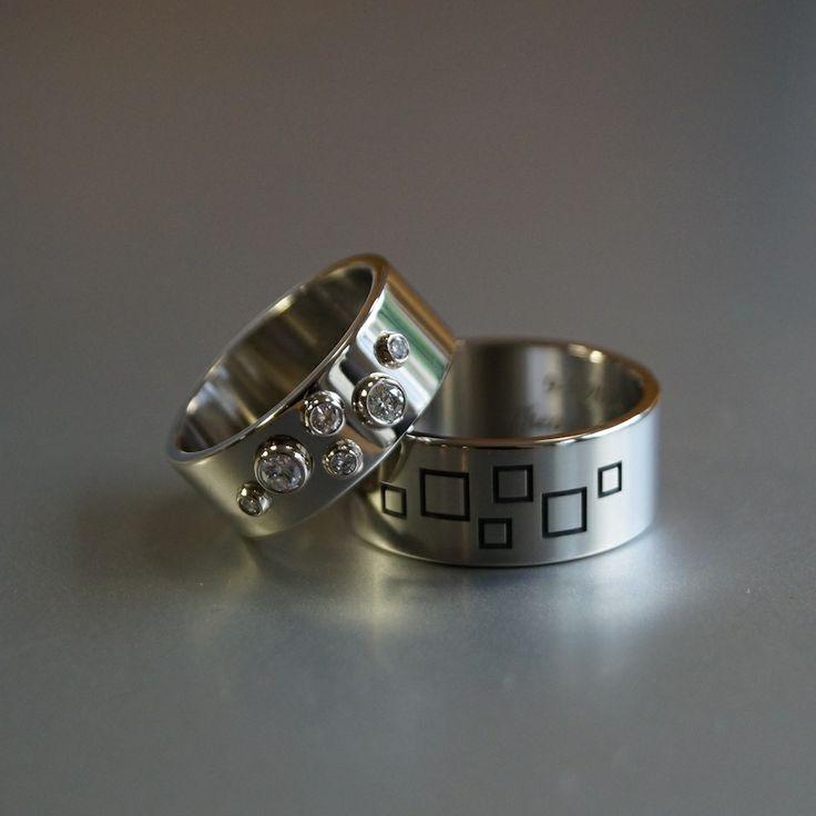 witgouden trouwringen met zes diamanten en gerhodineerde gravures