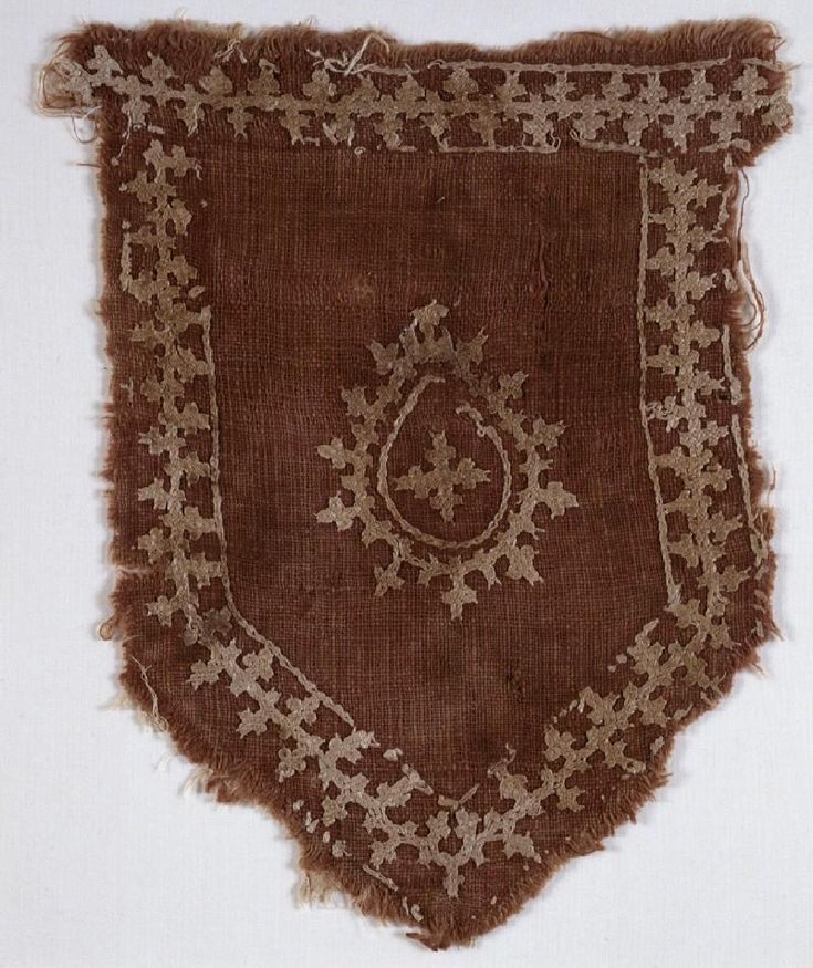 Tab from a Mamluk banner with linked crosses and pear-shaped medallion