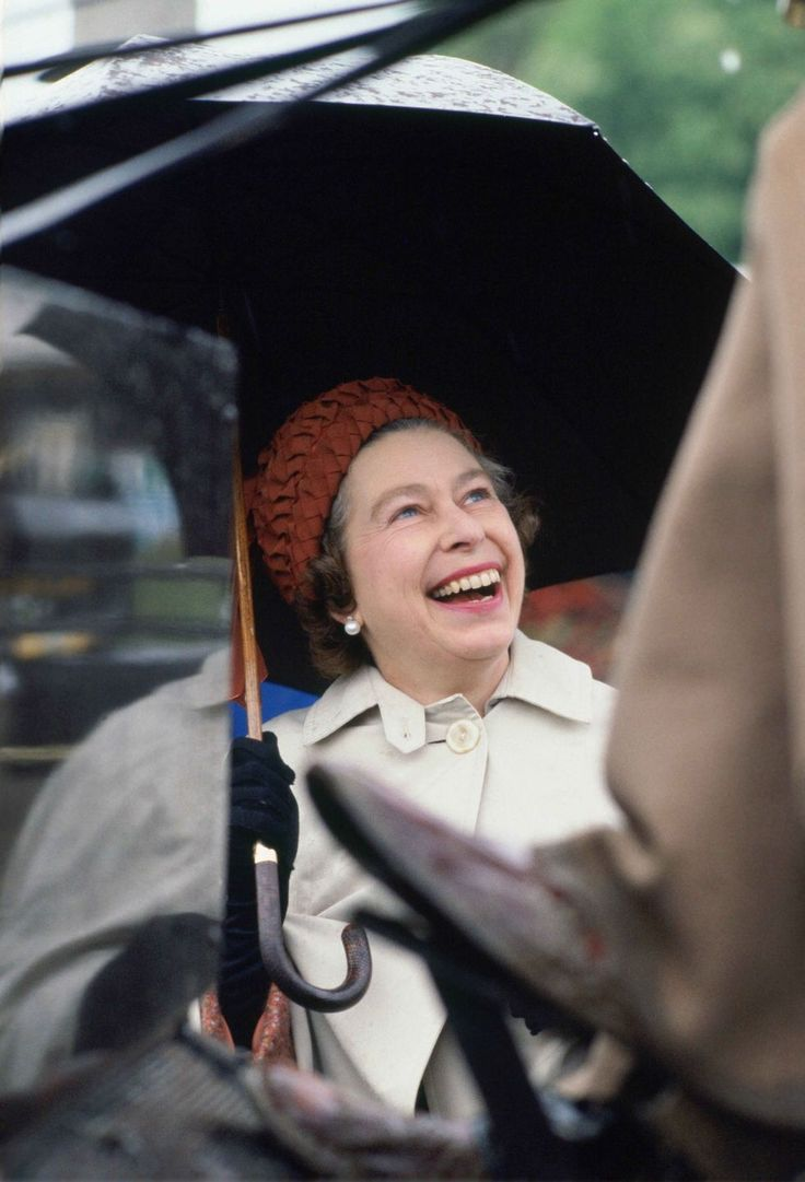 1978 Queen Elizabeth laughing while attending the Royal Windsor Horse Show.