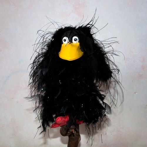 Crow puppet with ostrich feathers