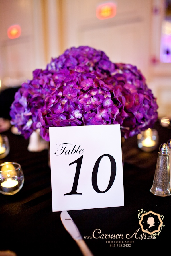 individually designed table numbers with a purple hydrangea centerpiece