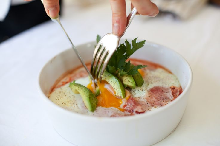 Baked eggs with Tuscan herbs and shaved leg of ham.  This is from my book Rocket Fuel on A Budget ..  www.energycoachinginstitute.com Photo by Helen Coetzee