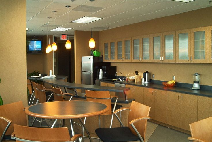 Plenty of cabinet space and counter tops offer a for Office lunch room design ideas