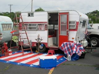 * You'll also appreciate having a synthetic RV mat or patio rug, like the flag-themed one above. Not only will it reduce the amount of dirt tracked into your trailer, it also will help define your outdoor living space. These can be found at RV stores or online. They weigh very little and are easy to sweep or hose off.